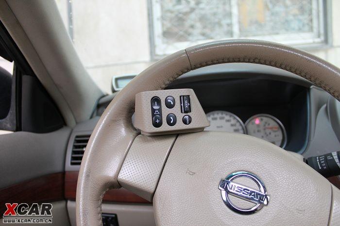 拆方向盘 无损安装轩逸多功能方向盘按键(cd方向盘控制按键)