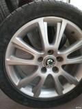 出明锐RS原装轮毂4个。13年5月份出厂的车