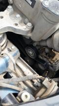 发动机怠速时有哒哒声,去看了说是皮带那里的转子有个坏了
