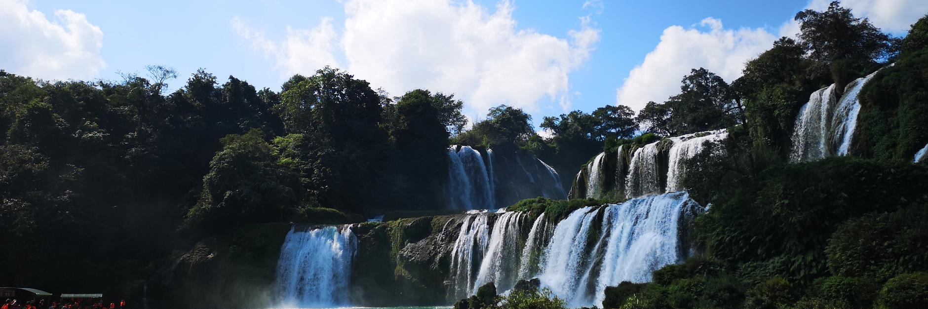 德天亚洲第一大瀑布的气势磅礴与涠洲岛五彩沙滩美景