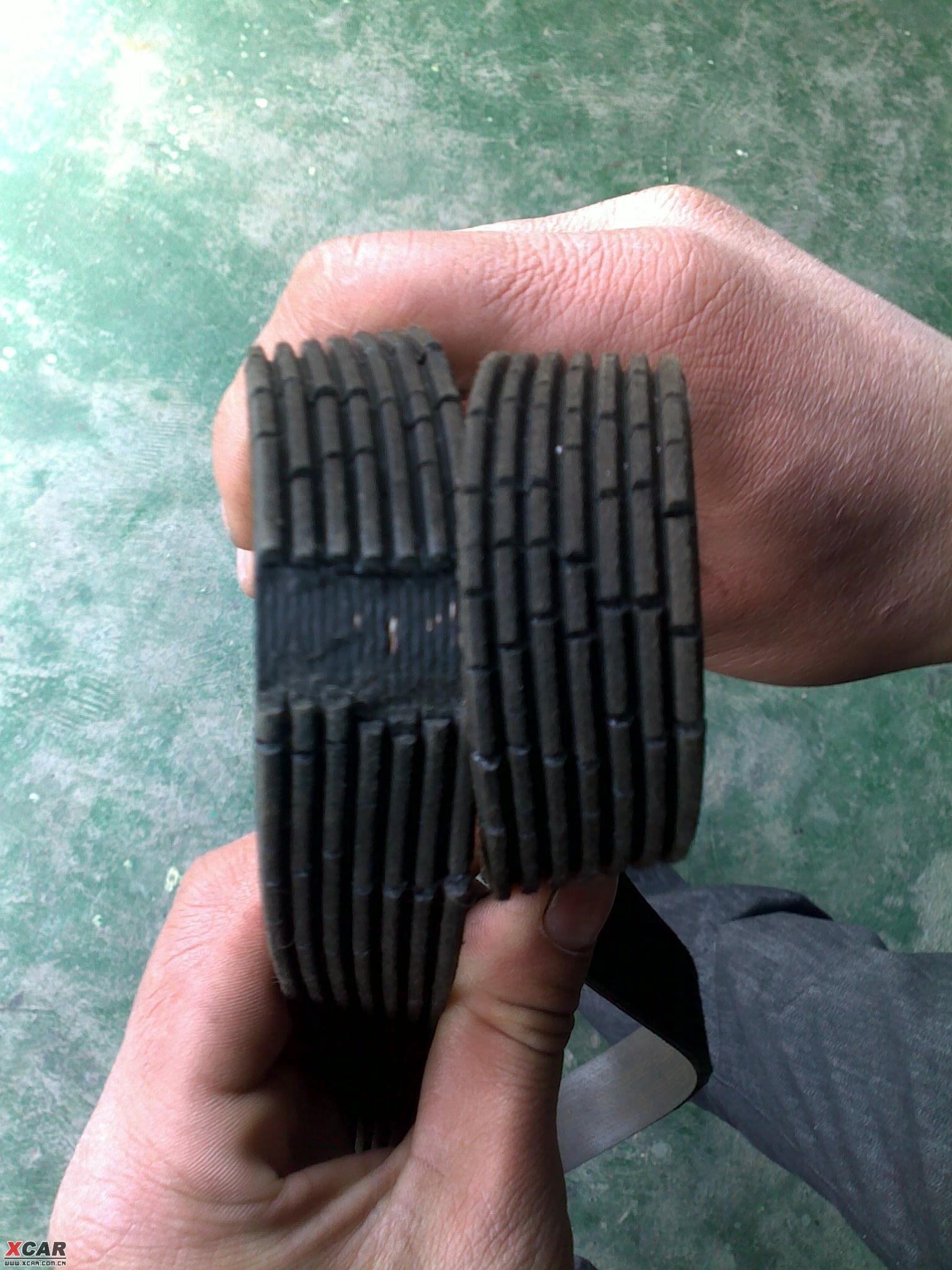 发电机皮带毁损,再次更换纯正原厂发电机皮带 2009年7月19高清图片